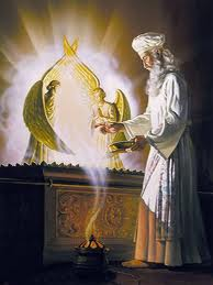 The High Priest Ministers before the Mercy Seat of YHVH